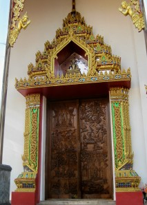 Buddha's Life in a Carved Door